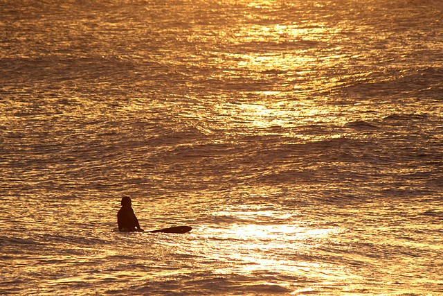 Sunset Surfing<br>North Shore Oahu, Hawaii<p>Camera: Canon EOS Rebel T1i<br>Canon 55-250mm IS lens